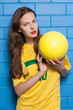 Beautiful young woman wearing brazilian football t-shirt