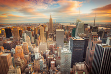 "Постер, картина, фотообои ""Sunset view of New York City looking over midtown Manhattan"""