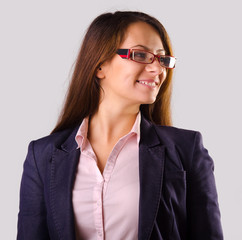 Beautiful business woman with glasses isolated on gray