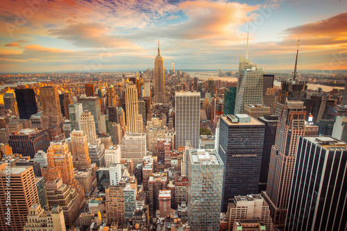 Poster Stad gebouw Sunset view of New York City looking over midtown Manhattan