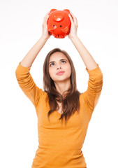 Brunette with piggy bank.