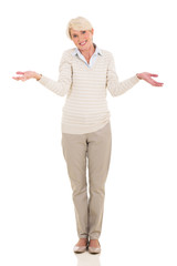 mature woman making helpless gesture