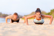 Push-ups fitness people working out on beach