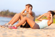 Situps on beach - young couple happy training - 66359151