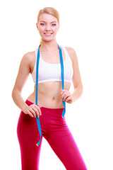Diet. Fitness woman fit girl with blue measure tape