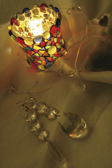 Crystal jewellery and a colourful candle