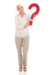 mature woman holding question mark
