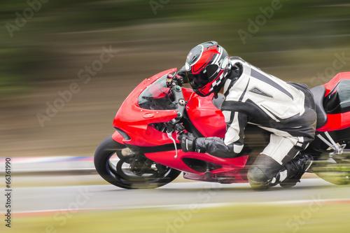 Foto op Plexiglas Motorsport Motorcycle practice leaning into a fast corner on track