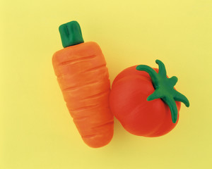 Plasticine carrot and tomato