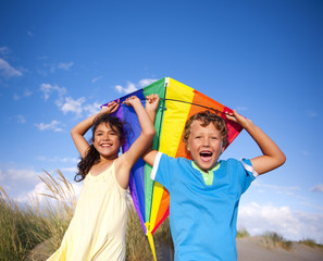 Cheerful Children Playing Kite Outdoors
