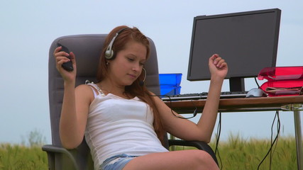 Young girl wearing headset listening music