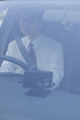 運転をするビジネスマン
