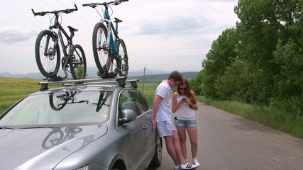 traveling by car with two bicycles mounted on bike roof carrier