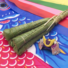 Rice dumplings wrapped in bamboo leaves on a carp streamer