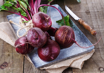 Organic beetroot over rustic wooden background