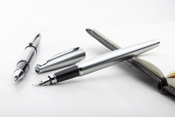 Silver fountain pen and roller pen