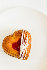 Heart-shaped cake with berry filling on a white plate