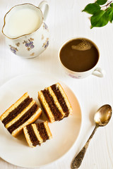 Apricot cakes and coffee with milk
