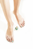 pedicure with green lacquer