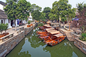 Landscape of Tongli watertown with traditional boats and old hou