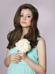 Nostalgia. Young Adorable Teen Girl with Peony Flower