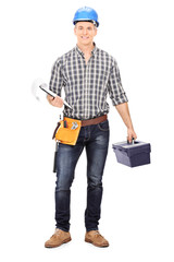 Engineer holding a toolbox and a clipboard