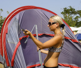 Girl collects or puts tent