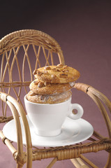 Homemade fresh cookies over coffee cup on a rocking chair