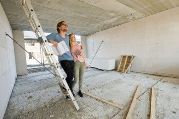 Young couple on construction site