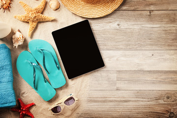Summer concept with tablet and accessories