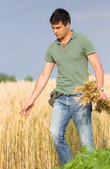 Happy farmer in wheat field