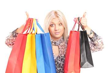 Surprised woman holding shopping bags
