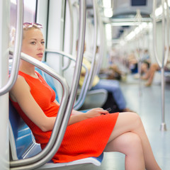 Lady traveling by metro.