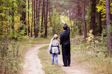 father and daughter in forest