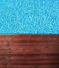 Swimming pool with wooden planks from top