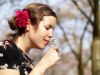 Beautiful girl smelling a cuckoo flower