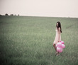 beautiful young women with pink balloons outdoor