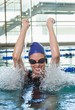 Excited swimmer cheering in the swimming pool