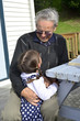 Great Granddad hug his great grandchild