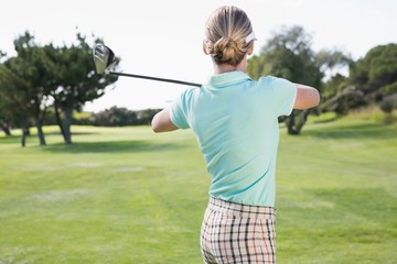 Female golfer taking a shot