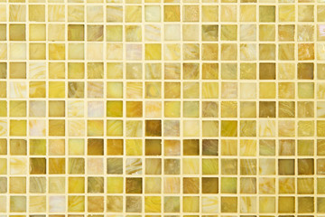 Texture: Beautiful yellow modern mosaic tile on wall.