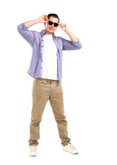 handsome young man with sunglasses enjoying over white
