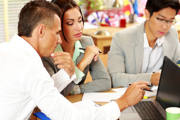 Business people working around table in office