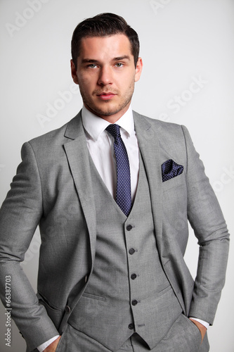 young fashion business man standing with his hands in his pocket