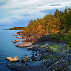 Evening at stony shore of Ladoga lake