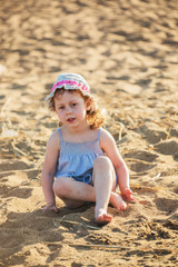 The little girl on a beach