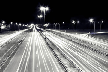 Highway traffic at night. Cars lights in motion. Transport