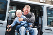 Disabled Men with son on Wheelchair Lift