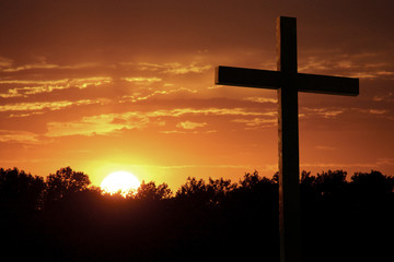 Dramatic Easter Sunrise With Bright Yelllow Sun and Large Cross
