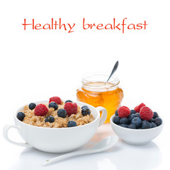 healthy breakfast, oat porridge with berries and honey, isolated